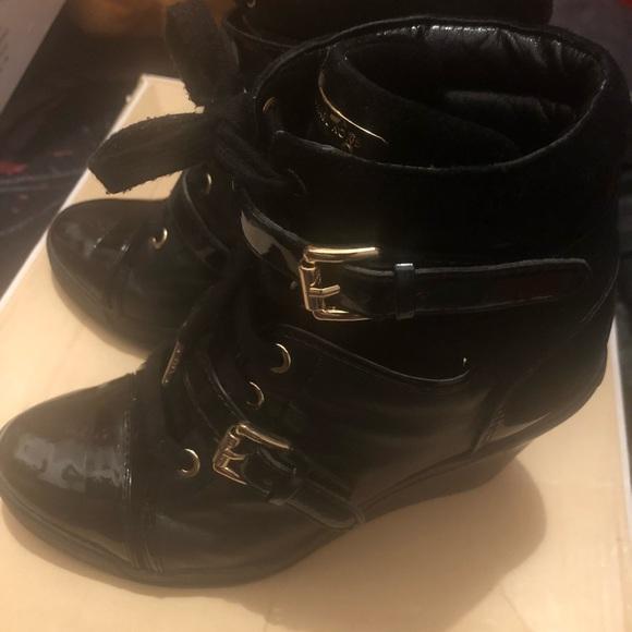 bdfa8679ada9 Nice leather wedge sneaker MK. M 5a8ecddd85e605702399e607. Other Shoes you  may like. Michael Kors ...
